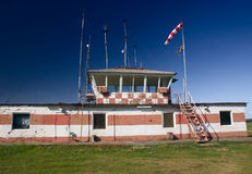 Flight control center. Old flight control center on sky background Stock Photos