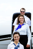 Flight crew exiting plane Royalty Free Stock Photography
