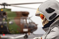 Flight Crew Fireman in Helmet Stock Images