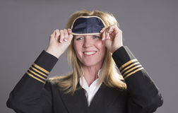 Flight crew officer putting on a eye shade Royalty Free Stock Photos
