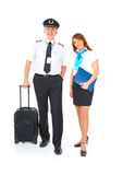 Flight crew with trolley. Flight crew. Cheerful pilot with trolley bag in hand and smiling flight attendant with documents wearing uniforms standing, isolated Royalty Free Stock Photo
