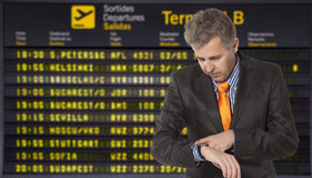 Flight delay. Businessman looking at his watch Stock Images