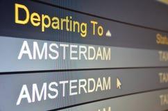 Flight departing to Amsterdam. Computer screen closeup of flight to Amsterdam status Stock Photo