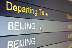 Flight departing to Beijing. Computer screen closeup of Beijing flight status Stock Image