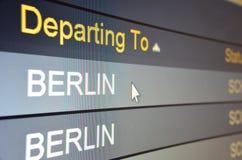 Flight departing to Berlin. Computer screen closeup of Berlin flight status Stock Photo