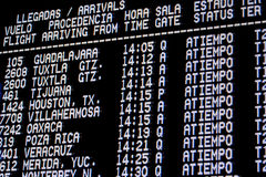 Flight departure board at airport. In Mexico Stock Photo