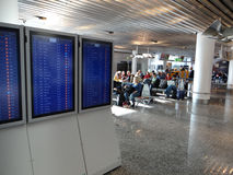 Flight Departures are shown on monitors Stock Photography