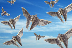 Flight of the Dollar Bills. A sky full of dollar bills shaped like butterflies Stock Photos