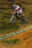 Flight Downhill Swiss Racer MTB. Downhill MTB Swiss Cycle Racer  flying mid air over the last big jump at the World Cup Downhill Mountain Cycle Event.Venue PMB Royalty Free Stock Image
