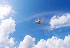 Flight drone, quadcopter on a blue sky background. stock images
