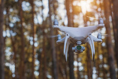In-flight drone quadrocopter with digital camera Stock Photo
