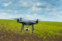 Flight of drones over bean field crops. Landscape royalty free stock images