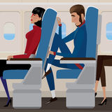 Flight in economy class Stock Images