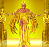 Flight Into Egyptian Fantasy. Adorned in a rich gold dress with golden wings; this Egyptian queen prepares to fly into the heart of the Pharaoh Royalty Free Stock Photos