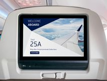 In-Flight Entertainment Screen, Inflight Screen, Seatback Screen in Airplane. LCD Screen in Passenger Seat royalty free stock photo