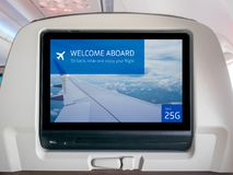 In-Flight Entertainment Screen, Inflight Screen, Seatback Screen in Airplane. LCD Screen in Passenger Seat royalty free stock images