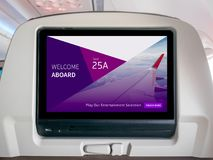 In-Flight Entertainment Screen, Inflight Screen, Seatback Screen in Airplane. LCD Screen in Passenger Seat royalty free stock image