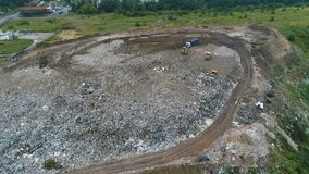 Flight forward over the landfill and garbage. Dumb stock video