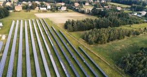 Flight forward over solar photovoltaic farm. stock footage