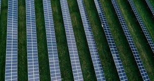 Flight forward over solar photovoltaic farm. stock video