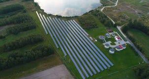 Flight forward over solar photovoltaic farm. stock video footage