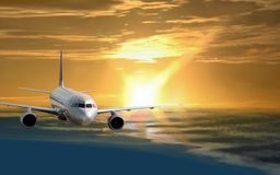 Flight in golden morning. Modern airplane is flying (arriving) in the morning sky with the sunrise on the background Royalty Free Stock Photos
