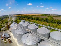 Flight of the grain terminal from the drone. The grain plant for storage and drying of grain. Grain terminal. Plant for. The drying and storage Rice plant in Royalty Free Stock Photo