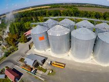 Flight of the grain terminal from the drone. The grain plant for storage and drying of grain. Grain terminal. Plant for. The drying and storage Rice plant in Royalty Free Stock Images