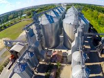 Flight of the grain terminal from the drone. The grain plant for storage and drying of grain. Grain terminal. Plant for. The drying and storage Rice plant in Stock Image