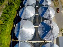 Flight of the grain terminal from the drone. The grain plant for storage and drying of grain. Grain terminal. Plant for. The drying and storage Rice plant in Stock Photography