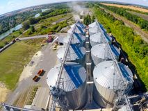 Flight of the grain terminal from the drone. The grain plant for storage and drying of grain. Grain terminal. Plant for. The drying and storage Rice plant in Royalty Free Stock Image