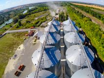 Flight of the grain terminal from the drone. The grain plant for storage and drying of grain. Grain terminal. Plant for. The drying and storage Rice plant in Stock Photo