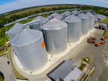 Flight of the grain terminal from the drone. The grain plant for storage and drying of grain. Grain terminal. Plant for. The drying and storage Rice plant in Royalty Free Stock Photos