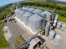 Flight of the grain terminal from the drone. The grain plant for storage and drying of grain. Grain terminal. Plant for. The drying and storage Rice plant in Royalty Free Stock Photography