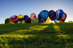 Flight of a group of hot air balloons in the summer royalty free stock photography