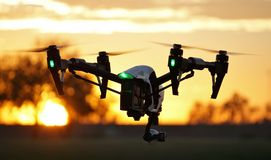 In Flight - Professional High Tech Camera Drone (UAV). Camera drone hovering at an R/C park Stock Photography