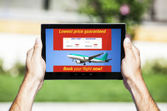Flight and hotel Deals website on tablet. Royalty Free Stock Photos