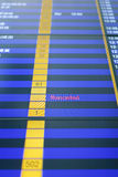 Flight information board in airport. Royalty Free Stock Image