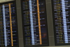 Flight information board in airport terminal Stock Image