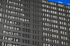 Flight information board in airport Stock Photos