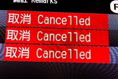 Flight information board with canceled flights. English ,Chinese stock image