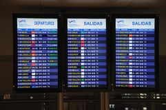 Flight information boards, Malaga Airport. Royalty Free Stock Photo