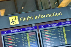 Flight information display panel showing departing flights Stock Images