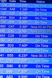 Flight information display screens at an airport Royalty Free Stock Image