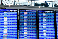 Flight information display screens at an airport Royalty Free Stock Photos