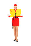 Flight instructions. A picture of an attractive stewardess presenting a life vest over white background royalty free stock image