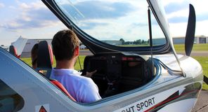 Flight instructor giving instruction to student. In Michigan royalty free stock photography