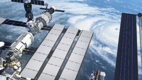 Flight Of The International Space Station Above The Large Hurricane