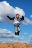 Flight on jump. Young boy flight on jump Royalty Free Stock Photo