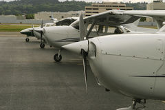 On The Flight Line. Airplanes are lined up as part of a flight line at a flight school stock images